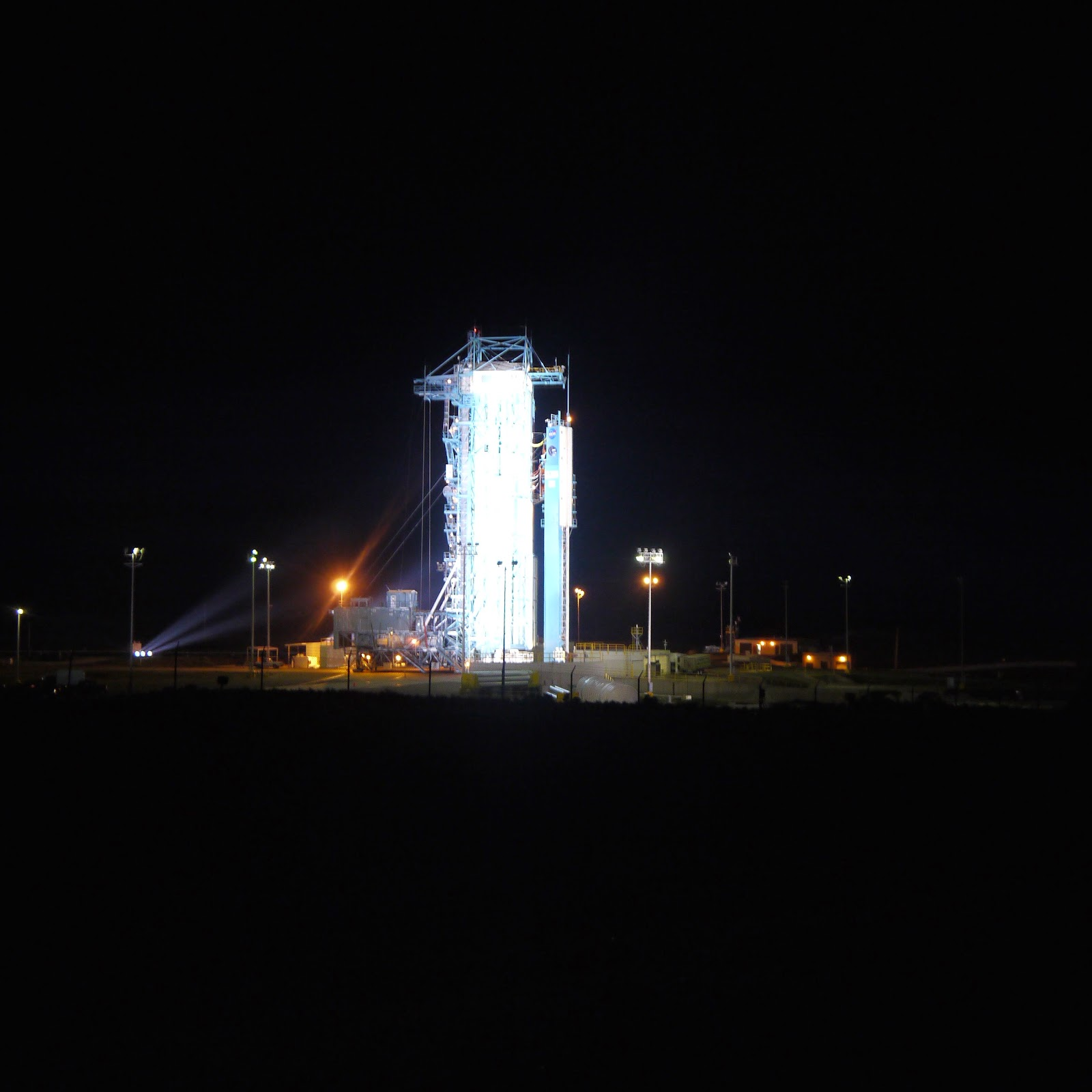 ef929309c13b4 The ULA rocket carrying the SMAP satellite is illuminated prior to tower  rollback.